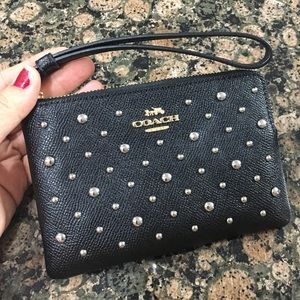 Authentic Coach leather studded corner zip wristle